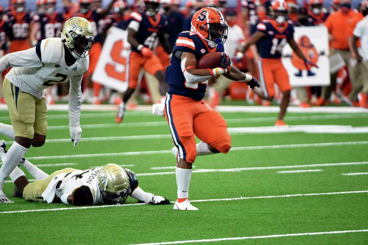 Syracuse running back Sean Tucker (34) runs for a touchdown in the first quarter against Georgia Tech during an NCAA college football game, Saturday, Sept. 26, 2020, at the Carrier Dome in Syracuse, N.Y. (Dennis Nett/The Post-Standard via AP)