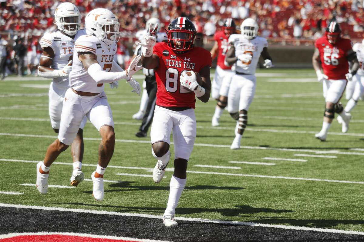 Texas Tech wide receiver Kesean Carter holds up two fingers as he scored his second touchdown of the game during the first half of an NCAA college football game against Texas Tech, Saturday Sept. 26, 2020, in Lubbock. (AP Photo/Mark Rogers)