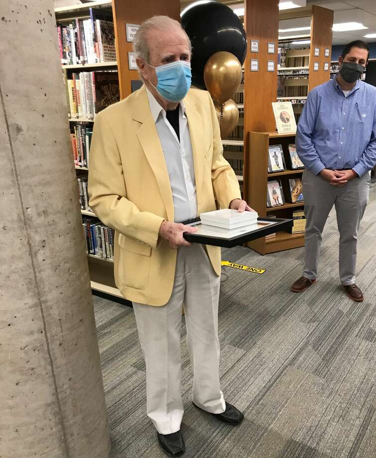 "In a ceremony at the Cromwell Belden Public Library, Donald M. Honig was given with a key to the town and presented with a proclamation declaring it ""Donald Honig Day."" Photo: Jeff Mill"