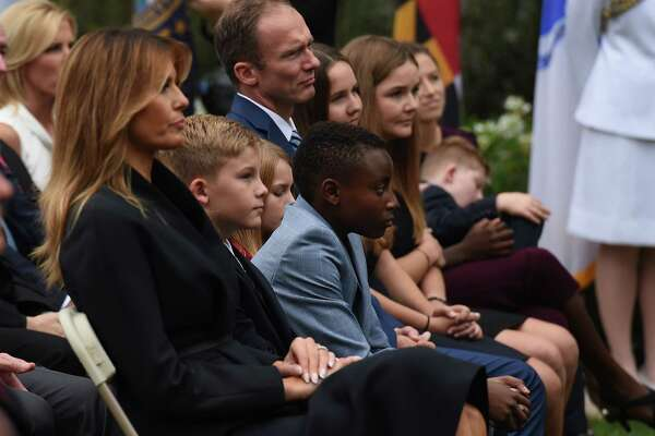 US First Lady Melania Trump (L) sits with Jesse Barret (2nd L), husband of US Supreme Court nominee Amy Coney Barrett and their children, in the Rose Garden of the White House in Washington, DC on September 26, 2020. (Photo by Olivier DOULIERY / AFP) (Photo by OLIVIER DOULIERY/AFP via Getty Images)