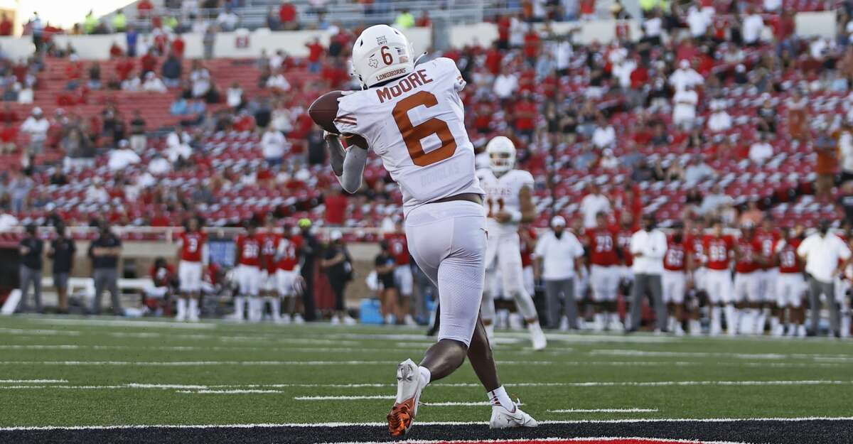 Texas' Joshua Moore (6) catches the ball for the game-winning touchdown during overtime of an NCAA college football game against Texas Tech, Saturday, Sept. 26, 2020, in Lubbock, Texas. (Brad Tollefson/Lubbock Avalanche-Journal via AP)