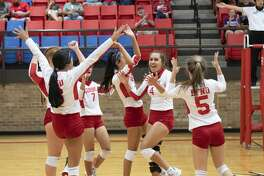 The Coahoma Bulldogettes celebrate after Ashley Romero, No. 4, spiked the ball for a kill during the Coahoma-Reagan County District 5-3A volleyball game held Saturday, Sept. 26, 2020, in Coahoma.