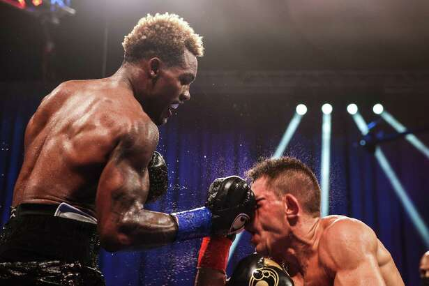 Jermall Charlo lands a big uppercut on Sergiy Derevyanchenko in their WBC middleweight fight on Saturday, Sept. 26, 2020 at Mohegan Sun Arena in Uncasville, Conn.