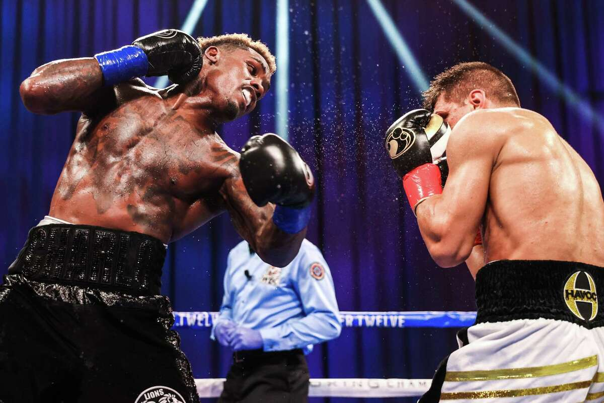 Jermall Charlo lands a left hand on Sergiy Derevyanchenko in their WBC middleweight fight on Saturday, Sept. 26, 2020 at Mohegan Sun Arena in Uncasville, Conn.