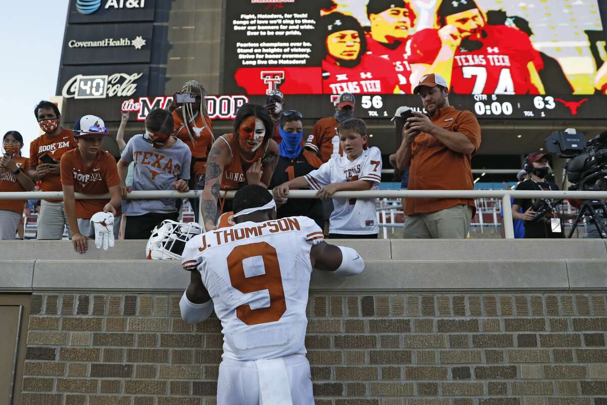 Texas' Josh Thompson (9) autographs gear for fans after an NCAA college football game against Texas Tech, Saturday, Sept. 26, 2020, in Lubbock, Texas. (Brad Tollefson/Lubbock Avalanche-Journal via AP)/