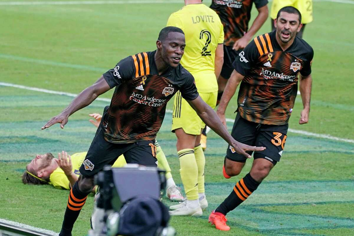 Houston Dynamo defender Maynor Figueroa (15) celebrates after scoring a goal against Nashville SC during the second half of an MLS soccer match Saturday, Sept. 26, 2020, in Nashville, Tenn. The game ended in a 1-1 draw. (AP Photo/Mark Humphrey)