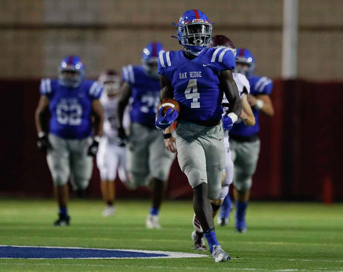 Oak Ridge running back Alton McCaskill (4) runs for a 99-yard touchdown during the fourth quarter of a non-district high school football game at Woodforest Bank Stadium, Saturday, Sept. 26, 2020, in Shenandoah.