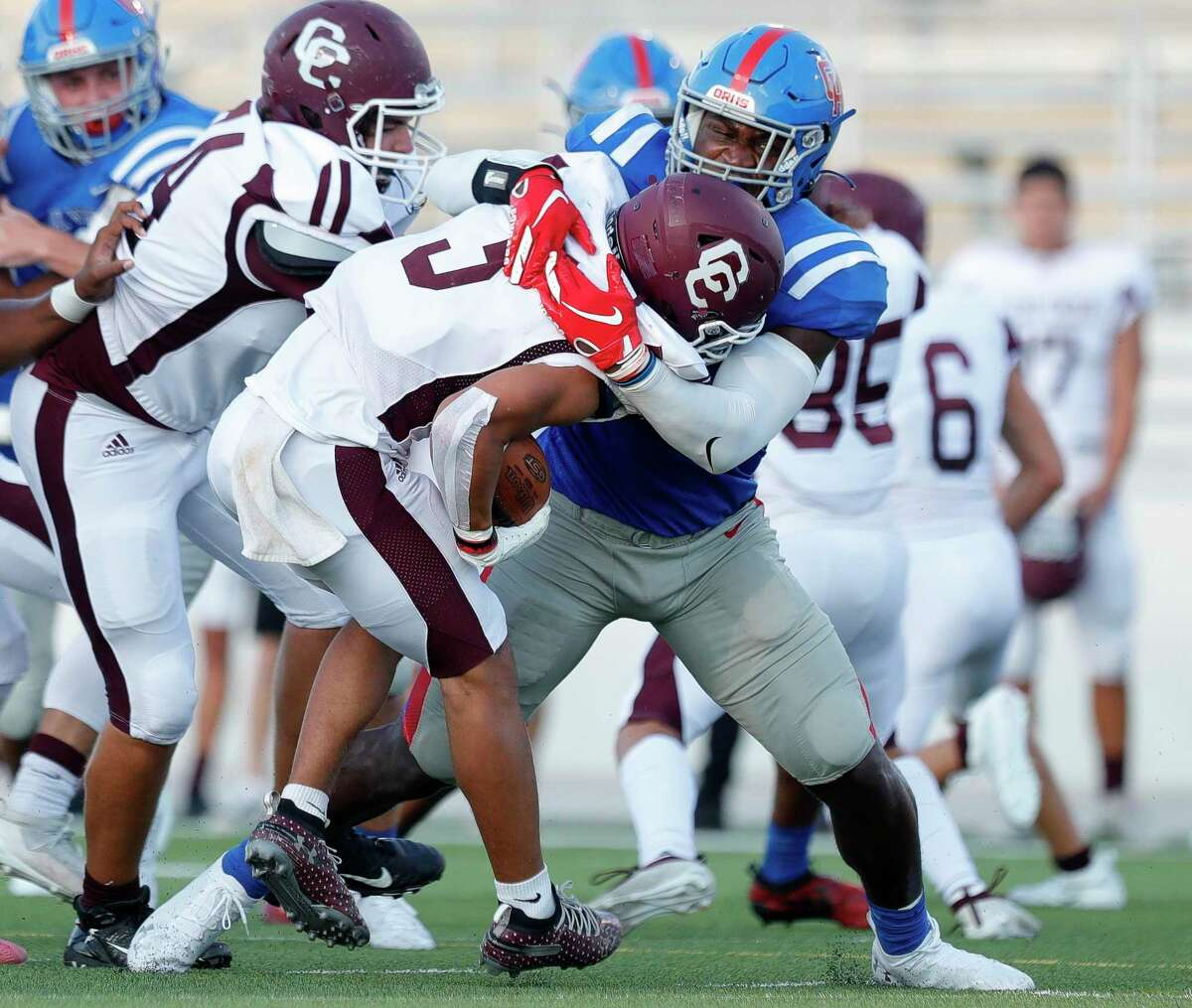 Oak Ridge outside linebacker KC Ossai (8) tackles Clear Creek running back Jeremiah Crum (5) for a loss on third down during the first quarter of a non-district high school football game at Woodforest Bank Stadium, Saturday, Sept. 26, 2020, in Shenandoah.