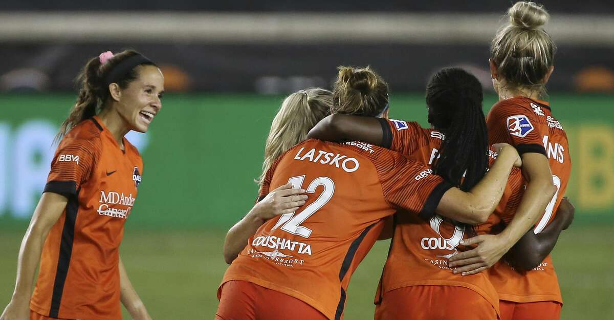Houston Dash players gather to celebrate Nichelle Prince's (8) goal at the 27th minute during the first half of a NWSL game against the Orlando Pride Saturday, Sept. 26, 2020, at BBVA Stadium in Houston.