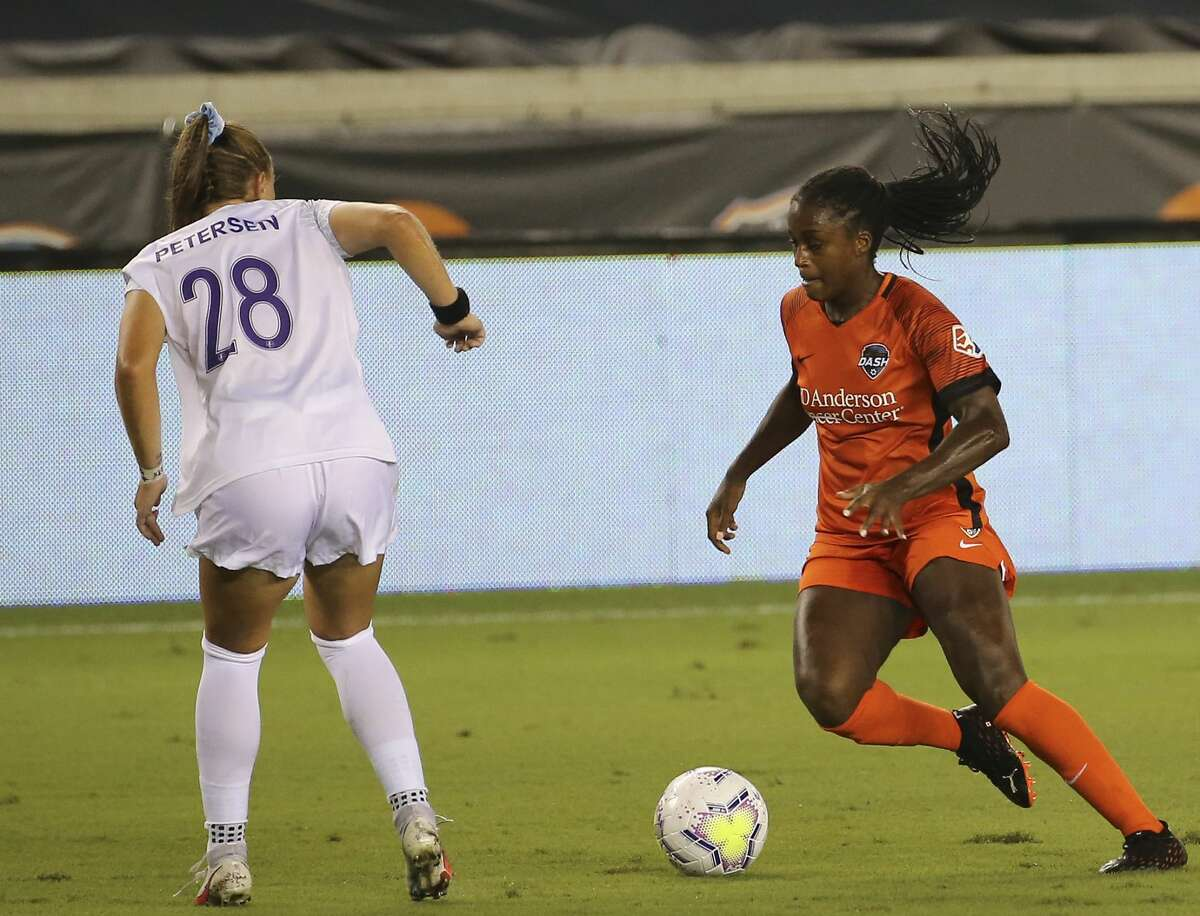 Houston Dash forward Nichelle Prince (8) dribbles while Orlando Pride defender Courtney Petersen (28) is defensing during the first half of a NWSL game Saturday, Sept. 26, 2020, at BBVA Stadium in Houston.