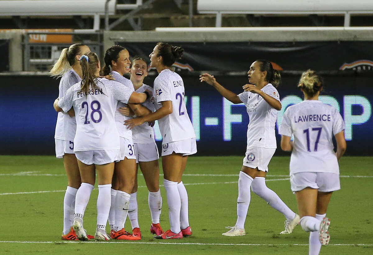 Orlando Pride players celebrate midfielder Marisa Viggiano's goal (23) during stoppage time of the first half of a NWSL game Saturday, Sept. 26, 2020, at BBVA Stadium in Houston.