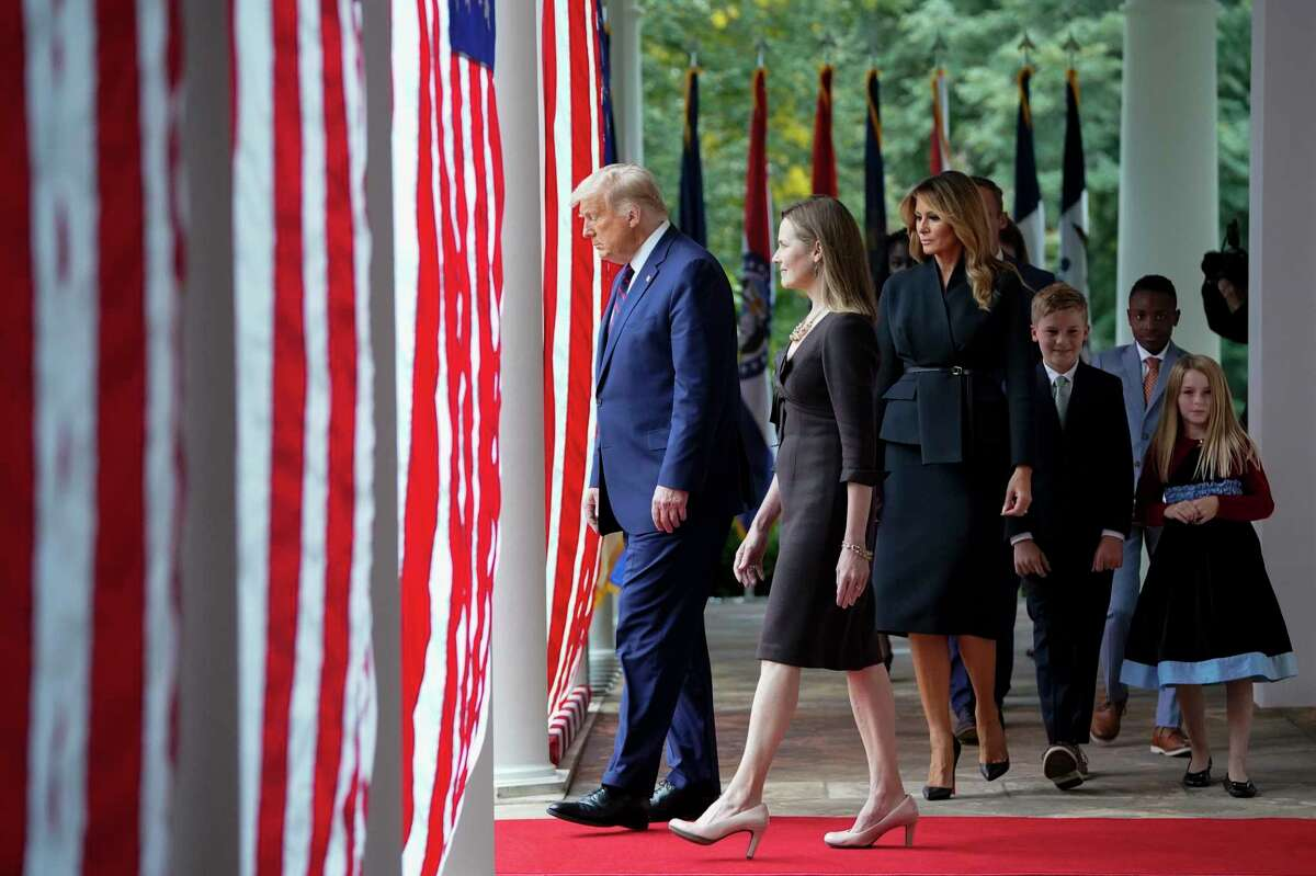 Donald Trump and Judge Amy Coney Barrett walk out as the president readies to announce her nomination to the Supreme Court on Saturday night at the White House.