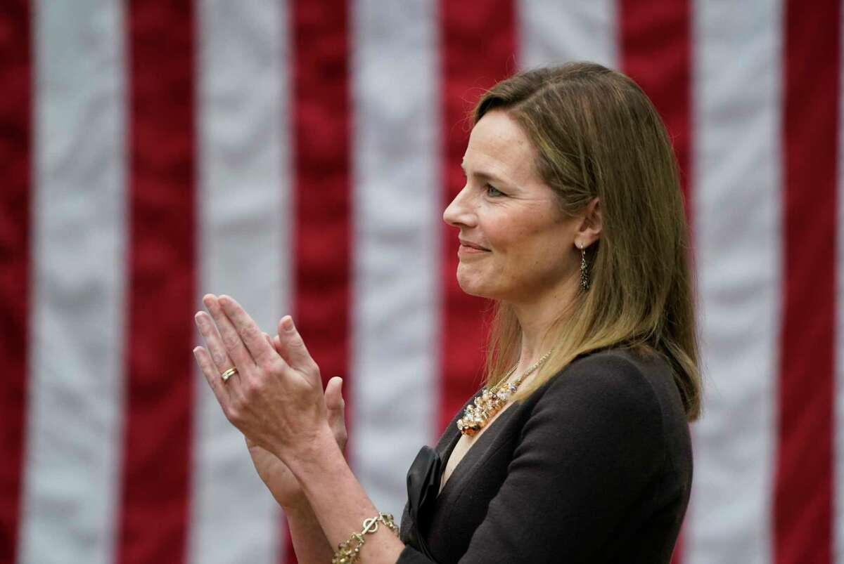 Judge Amy Coney Barrett applauds as President Trump announces her nomination to the Supreme Court on Saturday night at the White House.