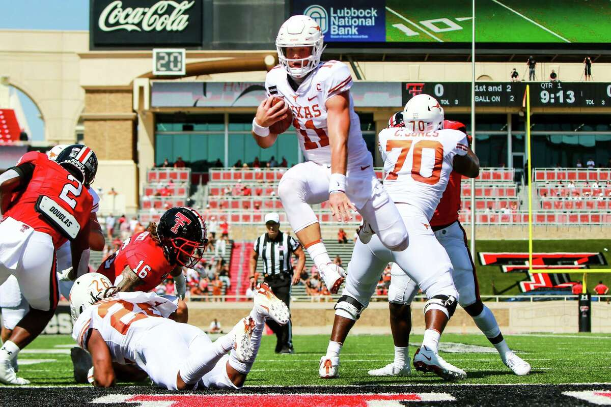 LUBBOCK, TEXAS - SEPTEMBER 26: Quarterback Sam Ehlinger #11 of the Texas Longhorns leaps to score a touchdown during the first half of the college football game against the Texas Tech Red Raiders on September 26, 2020 at Jones AT&T Stadium in Lubbock, Texas. (Photo by John E. Moore III/Getty Images)