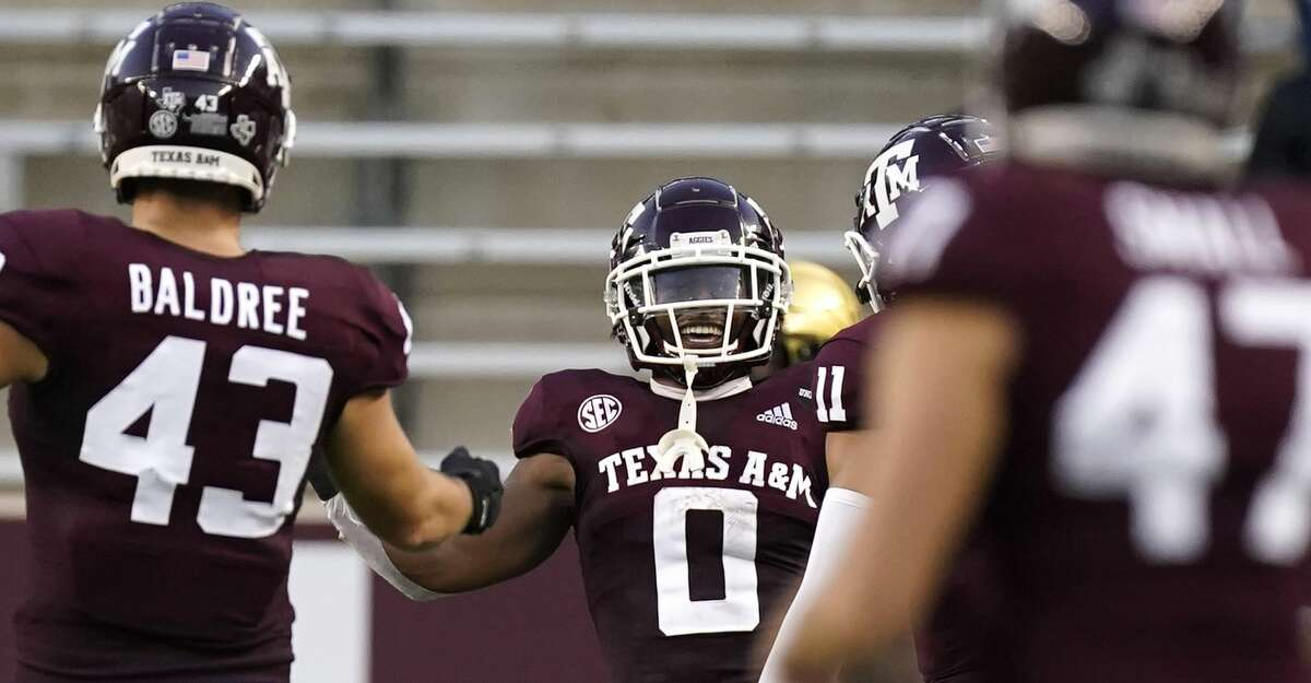 Texas A&M running back Ainias Smith (0) celebrates with Kellen Mond (11) and Cagan Baldree (43) after scoring a touchdown against Vanderbilt during the first half of an NCAA college football game Saturday, Sept. 26, 2020, in College Station, Texas. (AP Photo/David J. Phillip)