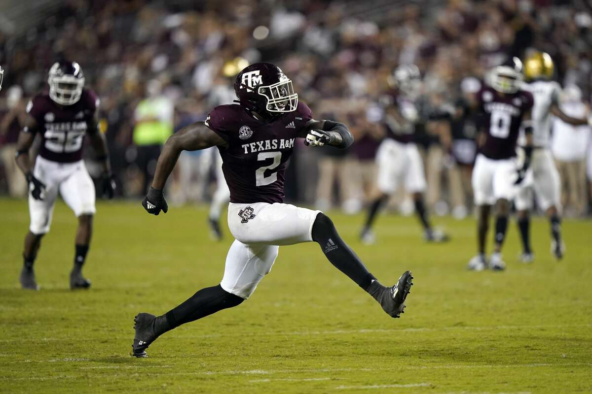 Texas A&M defensive lineman Micheal Clemons (2) celebrates after sacking Vanderbilt quarterback Ken Seals during the second half of an NCAA college football game Saturday, Sept. 26, 2020, in College Station, Texas. Texas A&M won 17-12. (AP Photo/David J. Phillip)