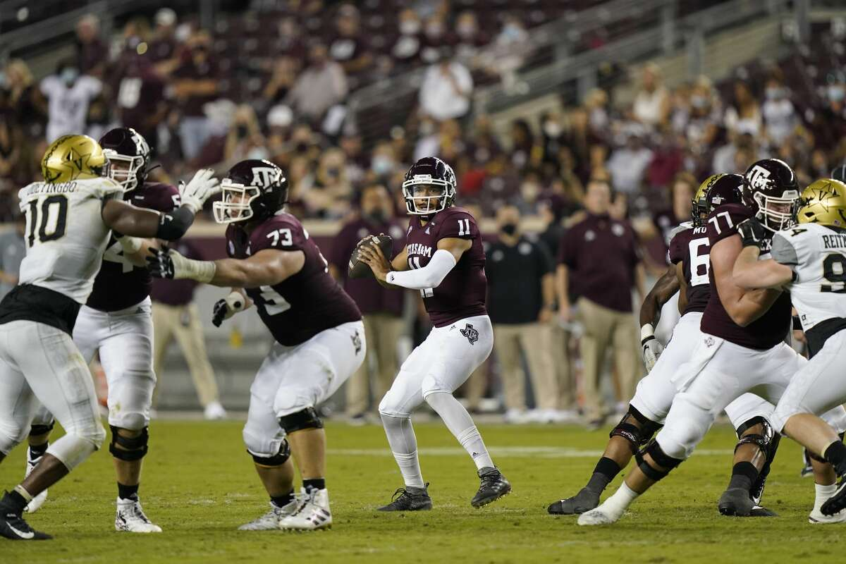 Texas A&M quarterback Kellen Mond (11) looks to throw a pass against Vanderbilt during the first half of an NCAA college football game Saturday, Sept. 26, 2020, in College Station, Texas. (AP Photo/David J. Phillip)