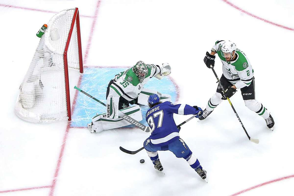 Anton Khudobin of the Dallas Stars makes a save against Yanni Gourde of the Tampa Bay Lightning in Game 5 of the Stanley Cup Finals. This season's race to the Cup will mean all-divisional play and a shortened season of 56 games.(Photo by Bruce Bennett/Getty Images)