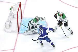 EDMONTON, ALBERTA - SEPTEMBER 26:  Anton Khudobin #35 of the Dallas Stars makes the save against Yanni Gourde #37 of the Tampa Bay Lightning during the first period in Game Five of the 2020 NHL Stanley Cup Final at Rogers Place on September 26, 2020 in Edmonton, Alberta, Canada. (Photo by Bruce Bennett/Getty Images)