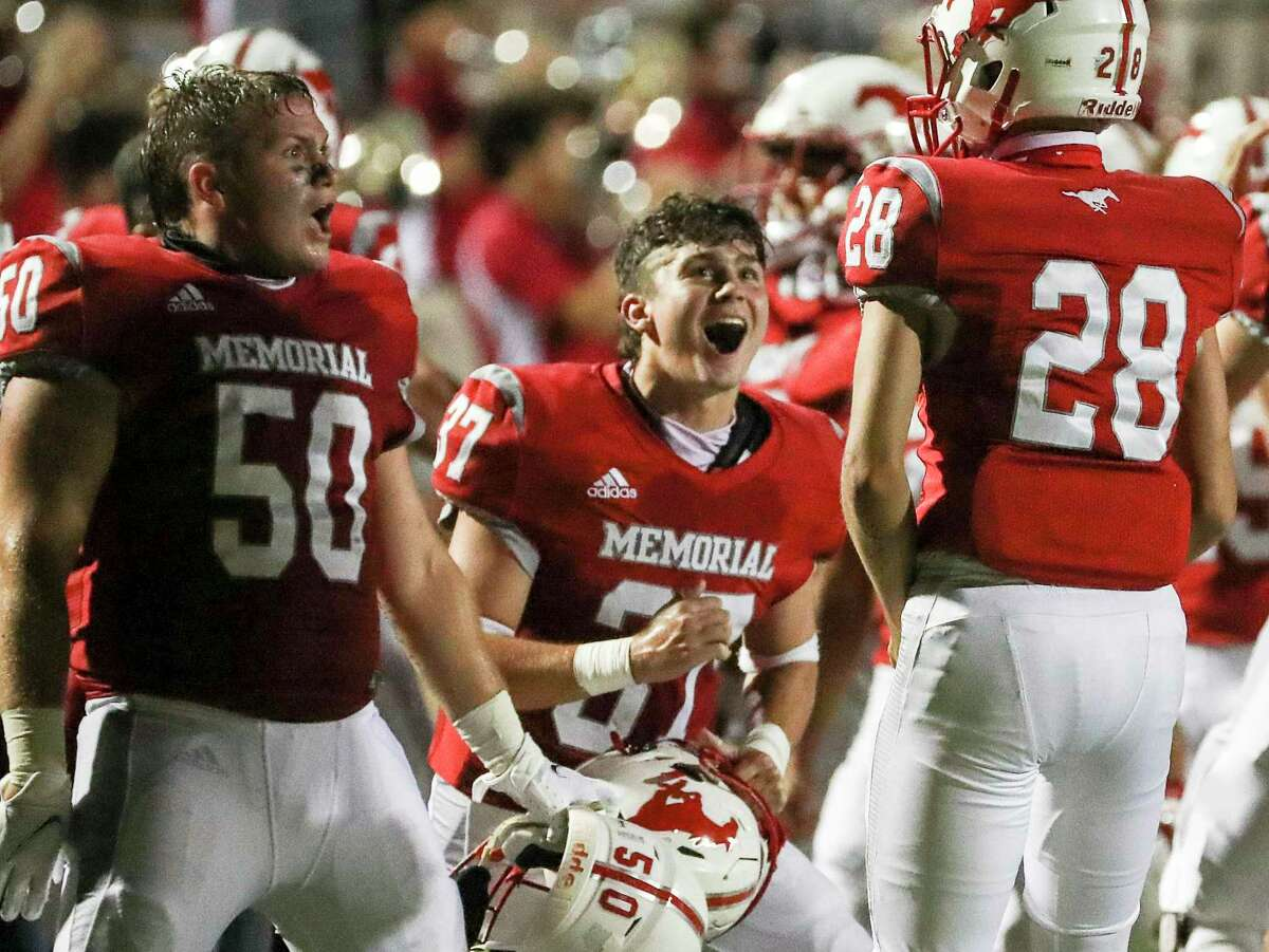 Memorial Mustangs Jack Dragna (50), Patrick Haas Smith (37) and linebacker Mueller Thomas (28) celebrate during the second half of a football game Thursday, Sept. 24 2020, at Darrell Tully Stadium in Houston.