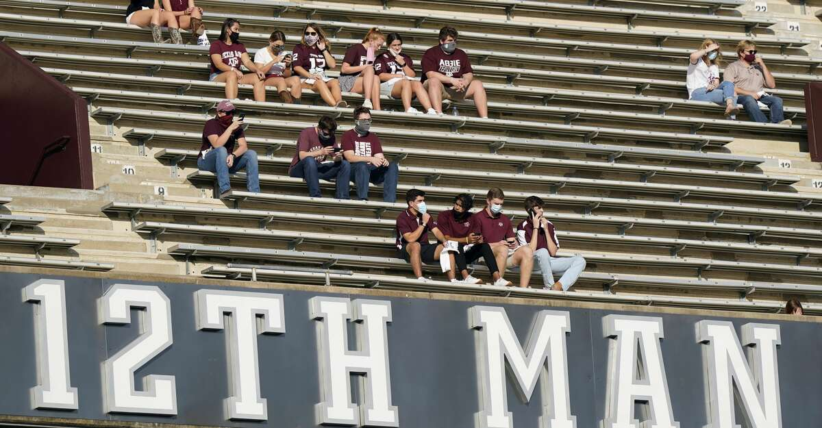 Fans wear masks as they sit in the student section of Kyle Field before an NCAA college football game between Vanderbilt and Texas A&M Saturday, Sept. 26, 2020, in College Station, Texas. (AP Photo/David J. Phillip)