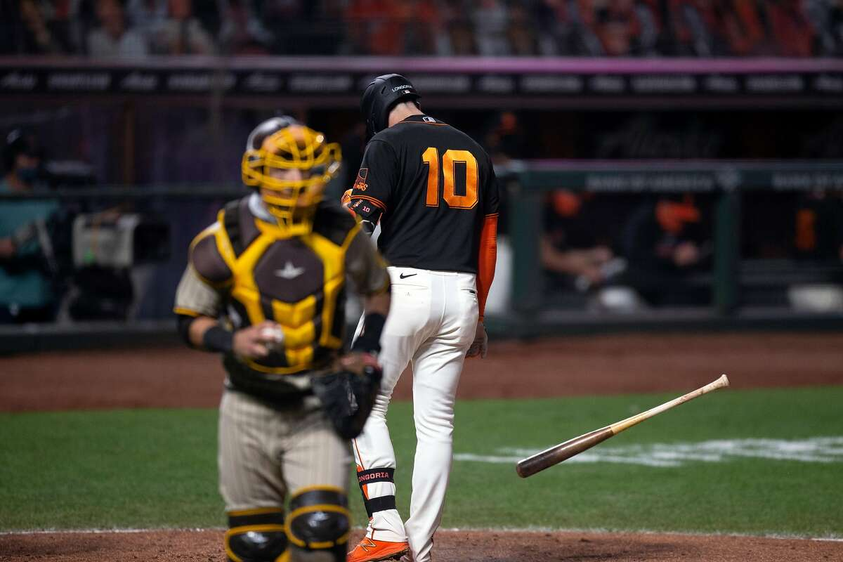San Francisco Giants third baseman Evan Longoria (10) throws down his bat after striking out to end the eighth inning of a Major League Baseball game against the San Diego Padres on Saturday, Sept. 26, 2020 in San Francisco, Calif.