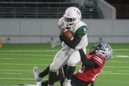 Kingwood Park's Isaiah Perez hauls in a 25-yard pass on the third play of the second half Saturday night. South Houston's Fidel Vizcaino comes up with the tackle.