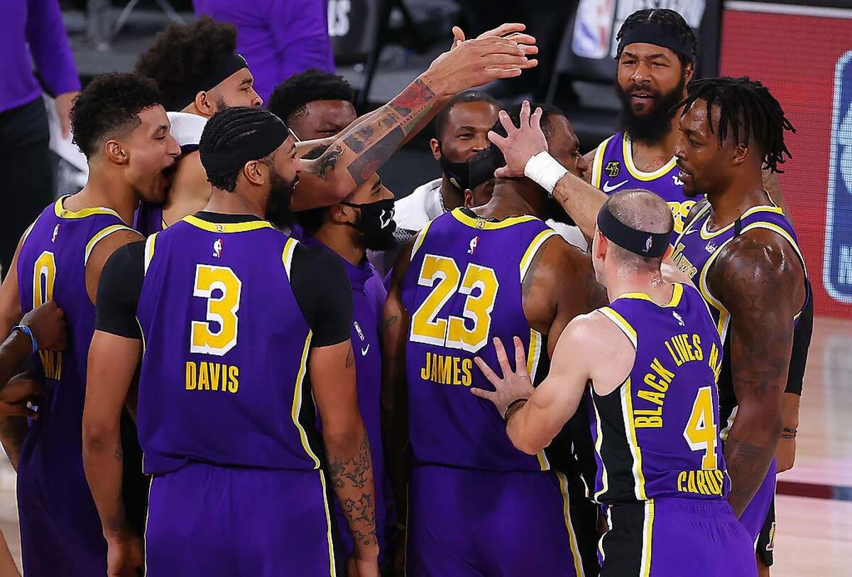 LAKE BUENA VISTA, FLORIDA - SEPTEMBER 26: LeBron James #23 of the Los Angeles Lakers celebrates with teammates after their win against the Denver Nuggets in Game Five of the Western Conference Finals during the 2020 NBA Playoffs at AdventHealth Arena at the ESPN Wide World Of Sports Complex on September 26, 2020 in Lake Buena Vista, Florida. NOTE TO USER: User expressly acknowledges and agrees that, by downloading and or using this photograph, User is consenting to the terms and conditions of the Getty Images License Agreement. (Photo by Kevin C. Cox/Getty Images)