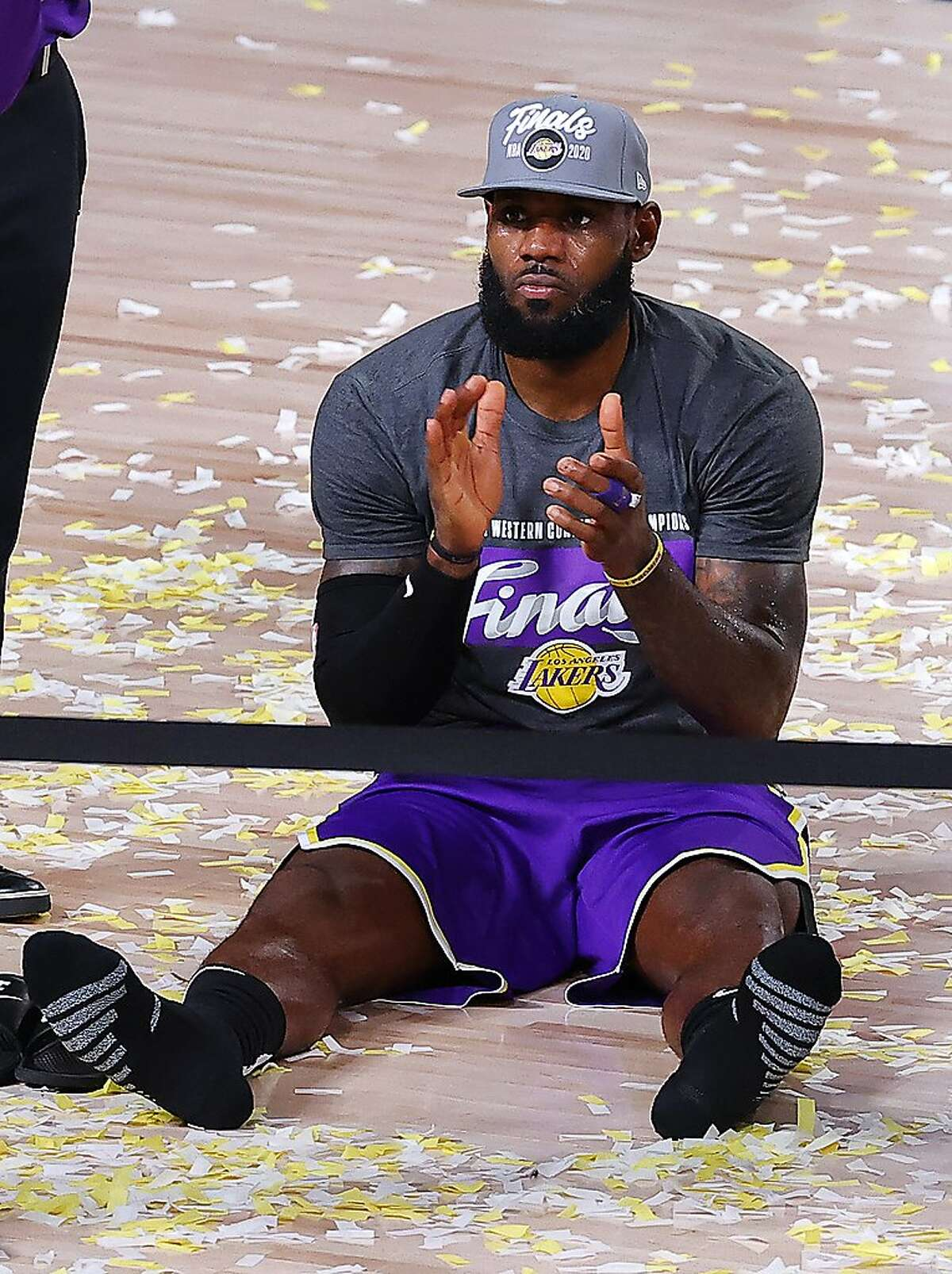 LeBron James has a seat among the confetti after the Lakers eliminated the Nuggets in the Western Conference finals.
