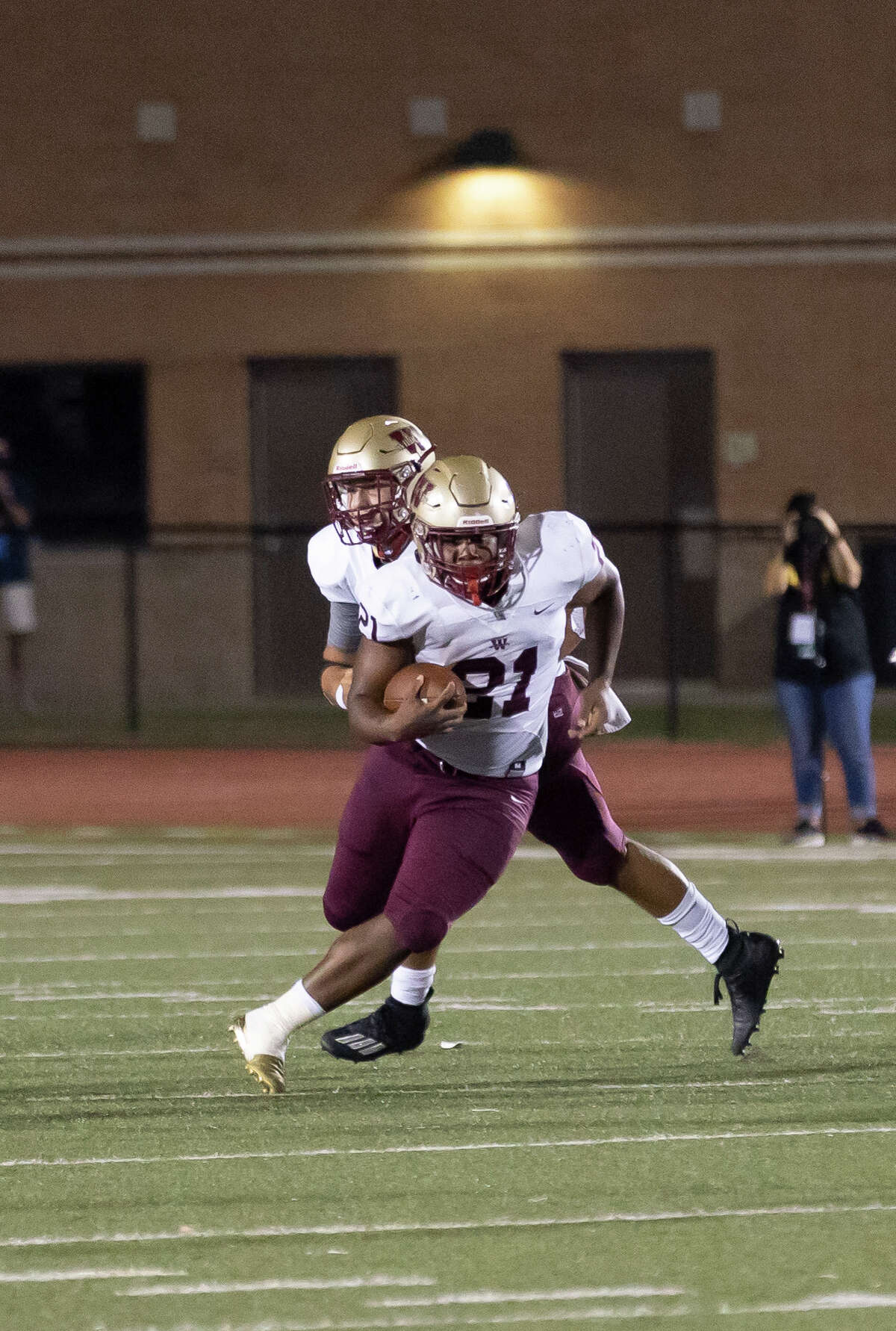 Cypress Woods running back Trayse Holmes (21) runs the ball down the field during the third quarter of a non-district football game against Kingwood at Turner Stadium in Humble, Saturday, Sept. 26, 2020.