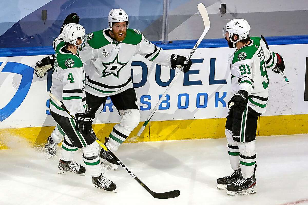 EDMONTON, ALBERTA - SEPTEMBER 26: Joe Pavelski #16 of the Dallas Stars is congratulated by his teammates after scoring a goal against the Tampa Bay Lightning during the third period in Game Five of the 2020 NHL Stanley Cup Final at Rogers Place on September 26, 2020 in Edmonton, Alberta, Canada. (Photo by Bruce Bennett/Getty Images)