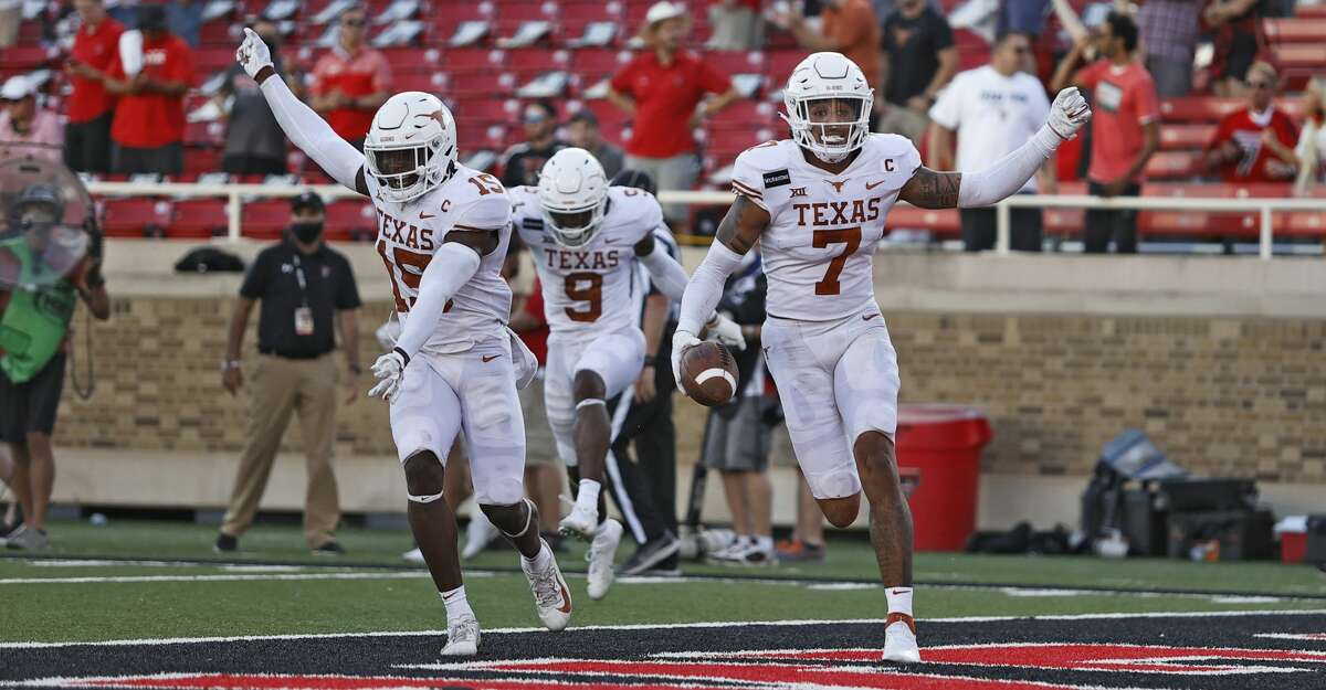 Texas' Caden Sterns (7) celebrates after intercepting the ball to win the game during overtime of an NCAA college football game against Texas Tech, Saturday, Sept. 26, 2020, in Lubbock, Texas. (Brad Tollefson/Lubbock Avalanche-Journal via AP)