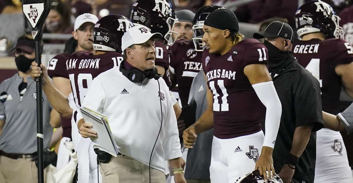 Texas A&M coach Jimbo Fisher, left, talks with quarterback Kellen Mond (11) during the first half of an NCAA college football game against Vanderbilt Saturday, Sept. 26, 2020, in College Station, Texas. (AP Photo/David J. Phillip)
