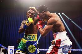 Jermell Charlo lands a punch against Jeison Rosario in a 154-pound unification fight on Saturday, Sept. 27, 2020 at Mohegan Sun Arena in Uncasville, Conn.
