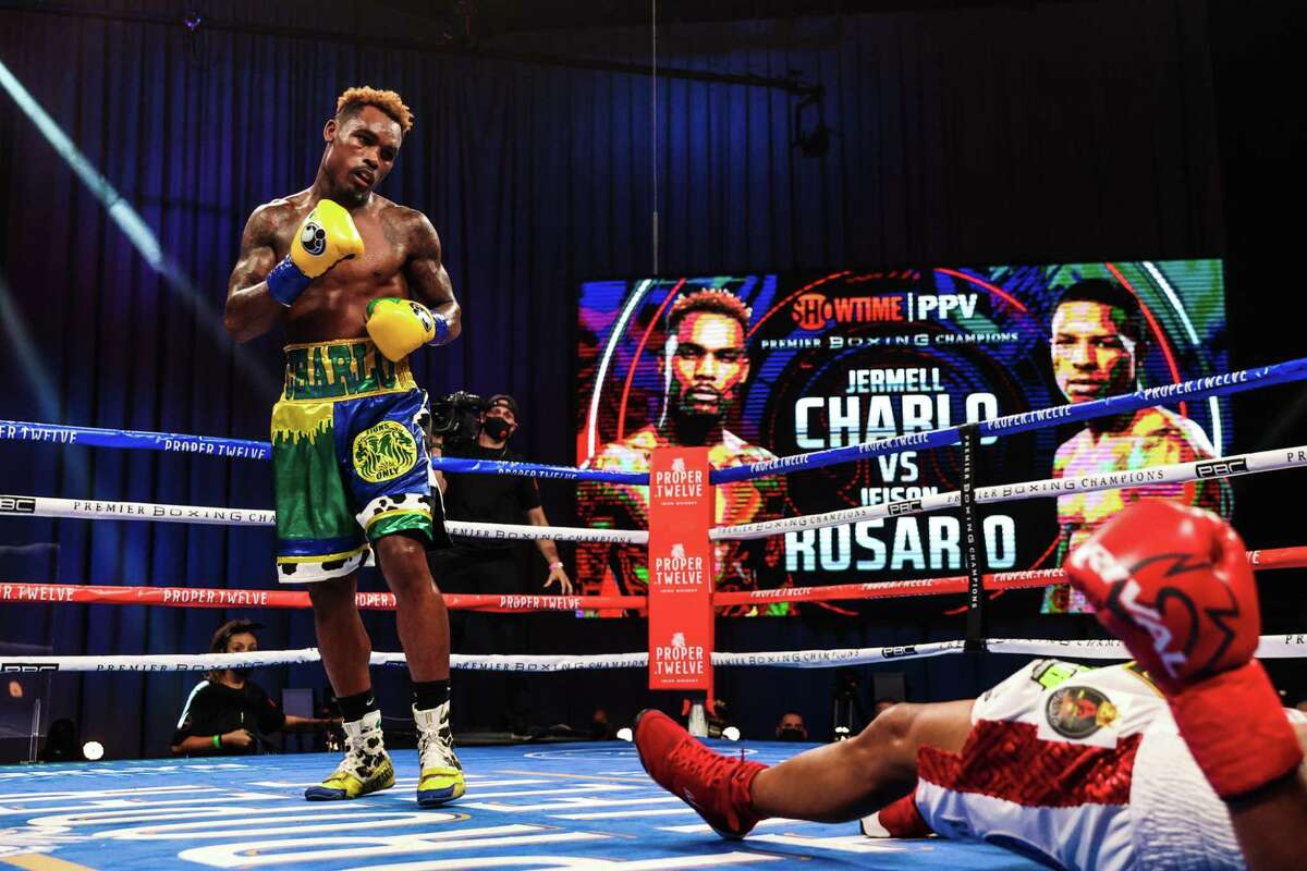Jermell Charlo watches Jeison Rosario try to catch is breath after Charlo knocked him down with a body punch in a 154-pound unification fight on Saturday, Sept. 27, 2020 at Mohegan Sun Arena in Uncasville, Conn.