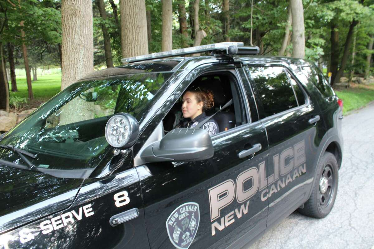 New Canaan Police Officer Annamaria Ceci monitors traffic on Smith Ridge in August of 2019. New Canaan Police will engage in a crackdown on distracted driving Oct. 1-15, 2020.