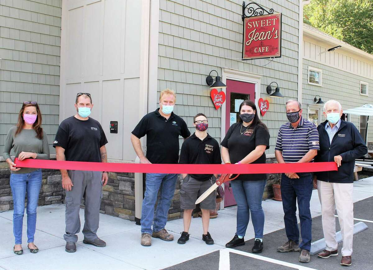 Sweet Jean's Café of East Hampton held a grand opening Sept. 25. From left are Middlesex County Chamber of Commerce vice president and Central Regional Tourism District Executive Director Johanna Bond, Disaster Restoration Services owner and Portland Division Chairman Dan Strong, Sweet Jean's co-owner Aaron Tyler, employee Christopher Guerin, co-owner Danielle Tyler, Belltown Motors and East Hampton Division Chairman Owen Flannery Chamber President Larry McHugh.