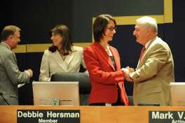 Mark Rosenker, right, with Deborah Hersman, who succeeded him as chair of the National Transportation Safety Board in 2009.