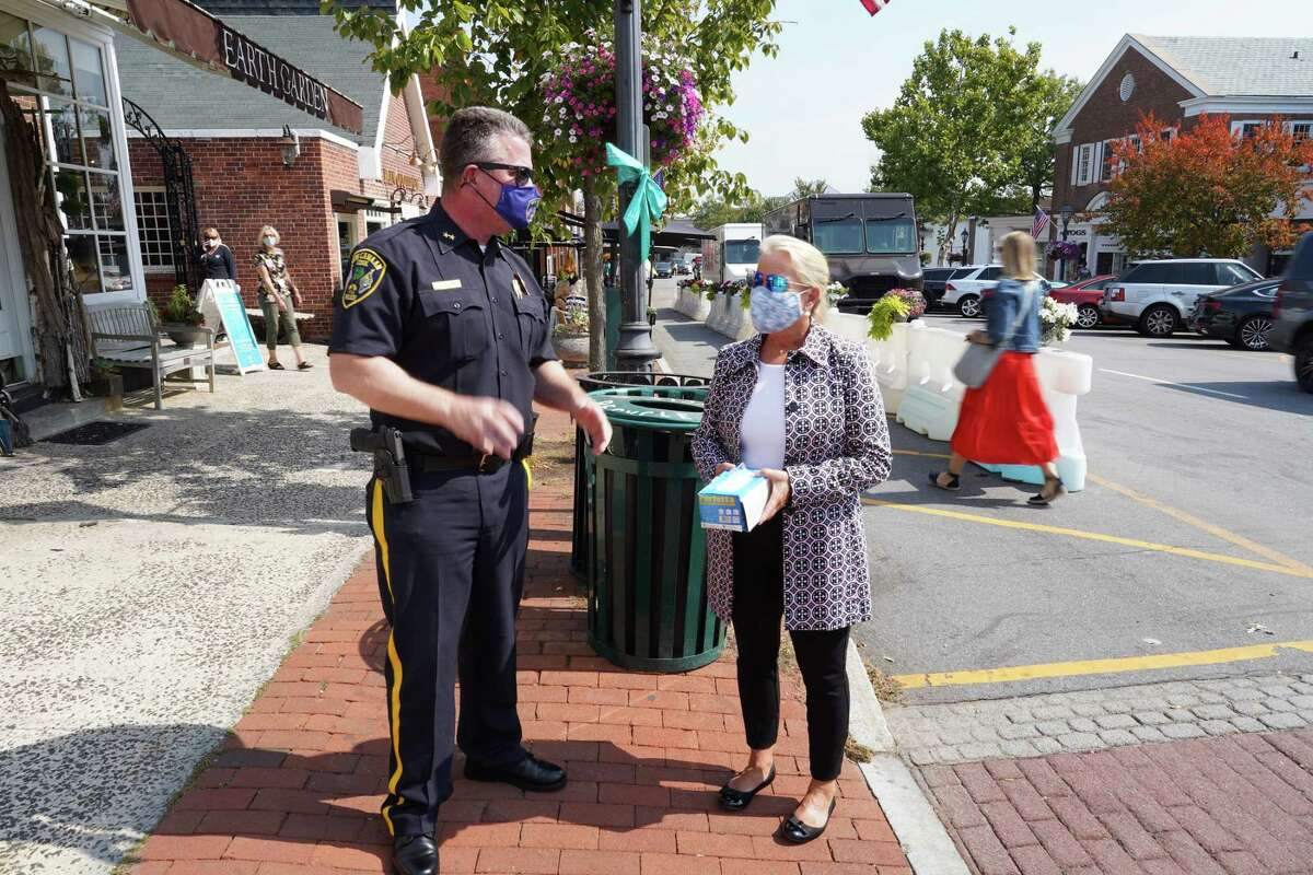 Chief of Police Leon Krolikowski stood in front of the New Canaan Playhouse on Elm Street with Administrative Officer Tucker Murphy to urge people to wear masks. Murphy held a box of masks so she could hand out one to anyone who was not wearing one on Friday, Sept. 25, 2020.