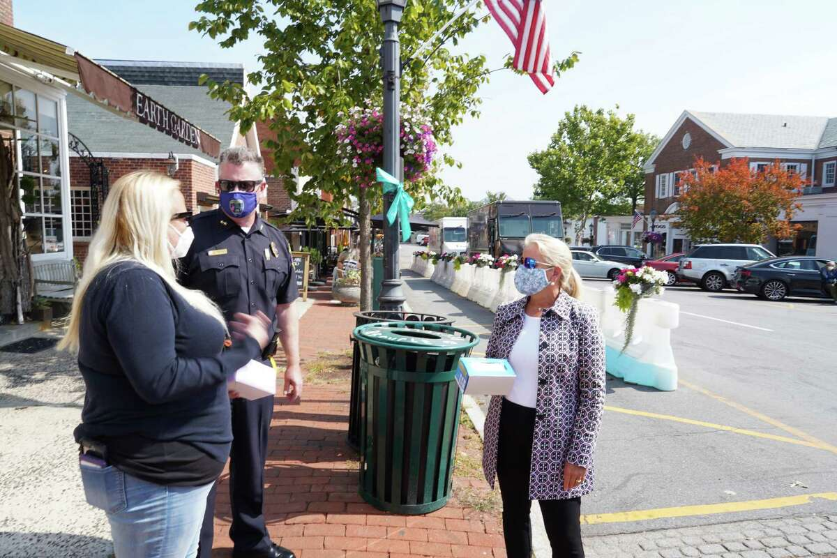 Director of Health Jen Eielson stood with Chief of Police Leon Krolikowski and Administrative Officer Tucker Murphy in front of the New Canaan Playhouse waiting to hand out masks to anyone not wearing one on Friday, Sept. 25, 2020.