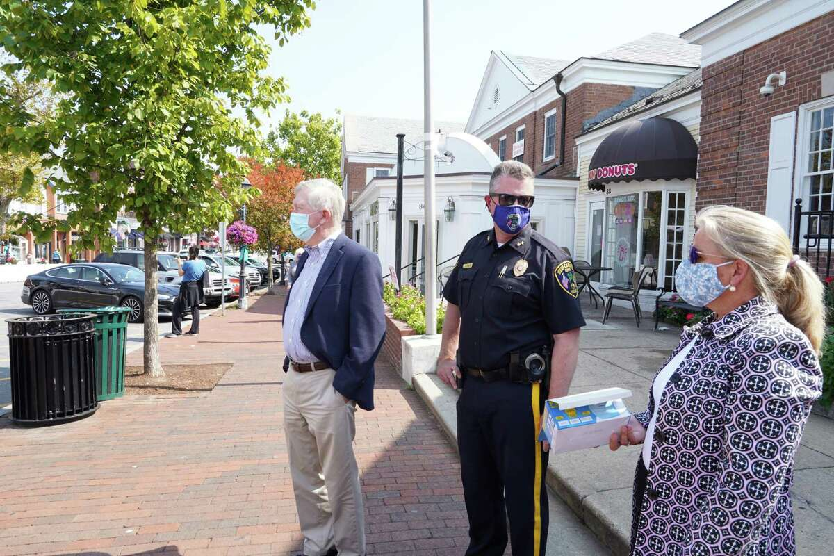 First Selectman Kevin Moynihan stood with Chief of Police Leon Krolikowski and Administrative Officer Tucker Murphy across from the New Canaan Playhouse waiting to hand out masks to anyone not wearing one on Friday, Sept. 25, 2020.