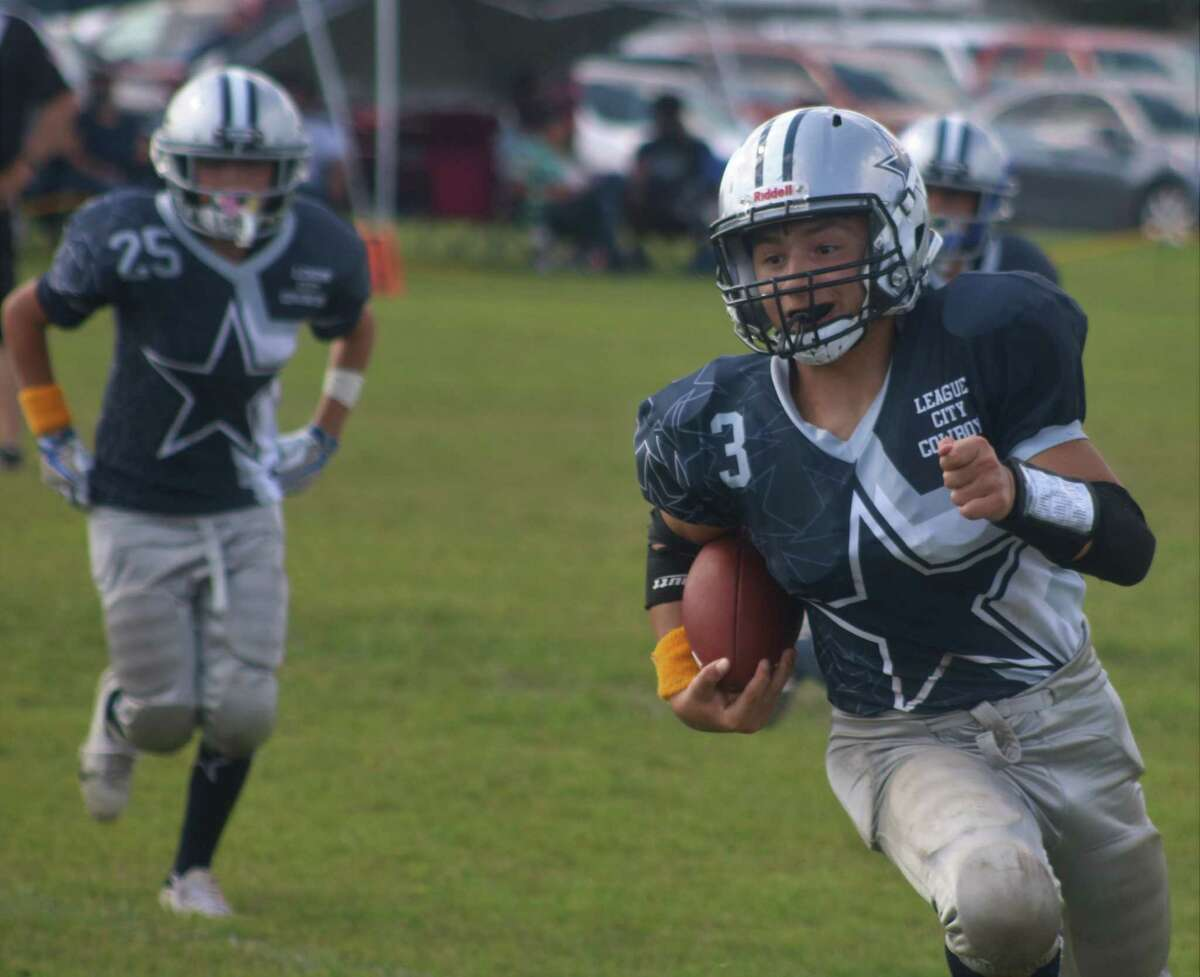 League City Senior Cowboy Michael Pugh, Jr. darts to the outside, heading for one of his three touchdowns Saturday afternoon.