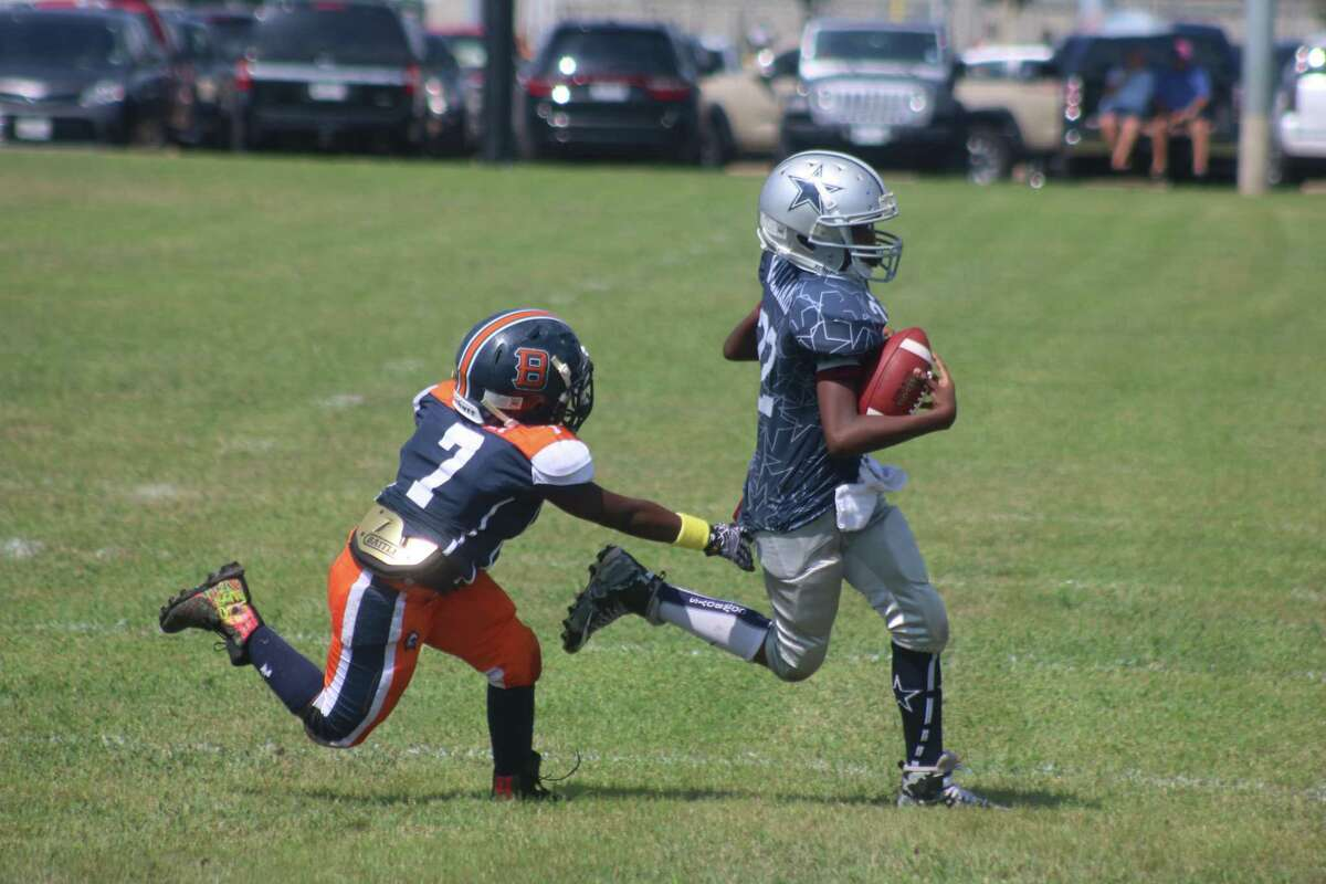 League City Junior Cowboys running back Kingston Williams was eluding defenders all day long Saturday in helping the team up their mark to 3-0.
