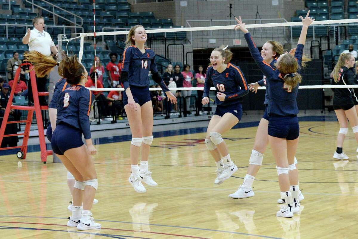 The Seven Lakes Spartans celebrate their 3-0 victory over the Ft. Bend Austin Bulldogs in a Class 6A Region III bi-district volleyball playoff match on Tuesday, November 5, 2019 at the Leonard Merrell Center, Katy, TX.