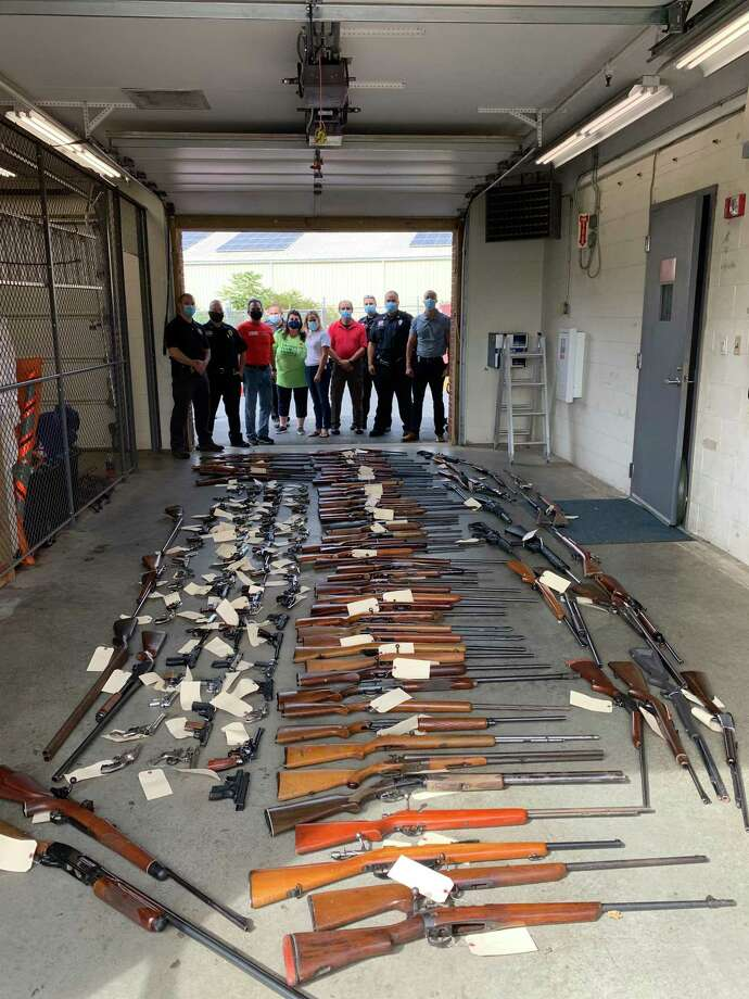 The Guilford Police Department collected 198 guns during its second annual guy buy-back and safe firearm storage event, held Saturday, Sept. 26, in conjunction with the Ethan Miller Strong Foundation and Swords to Plowshares Northeast. Photo: Guilford Police Department / Contributed Photo / New Haven Register Contributed