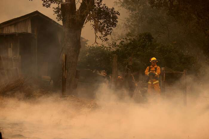 ST HELENA, CALIFORNIA - SEPTEMBER 26: A firefighter monitors the Glass Fire on September 26, 2020 in Napa, California. The fast moving Glass fire has burned over 1,000 acres and prompted evacuations. Much of Northern California is under a red flag warning for high fire danger through Monday evening. (Photo by Justin Sullivan/Getty Images)