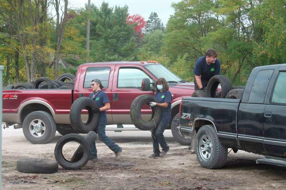 Bear Lake High School volunteers join Manistee County Recycling Coordinator Sarah Archer in unloading scrap tires on Saturday duringManistee County's 2020 scrap tire event atBay Area Recycling for Charities in Kaleva. (Erin Glynn/News Advocate)