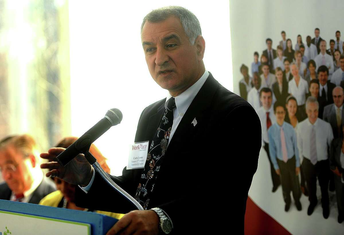 State Senator Carlo Leone, D-27, speaks at the graduation ceremony for The WorkPlace's Platform to Employment program at the Discovery Museum in Bridgeport, Conn. on Tuesday, December 11, 2018. Since its inception, the program has helped over 1000 long-term unemployed residents find new jobs.