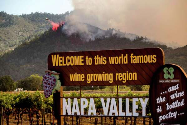 An air tanker drops retardant on the Glass Fire burning in Calistoga, Calif., on Sunday, Sept. 27, 2020.