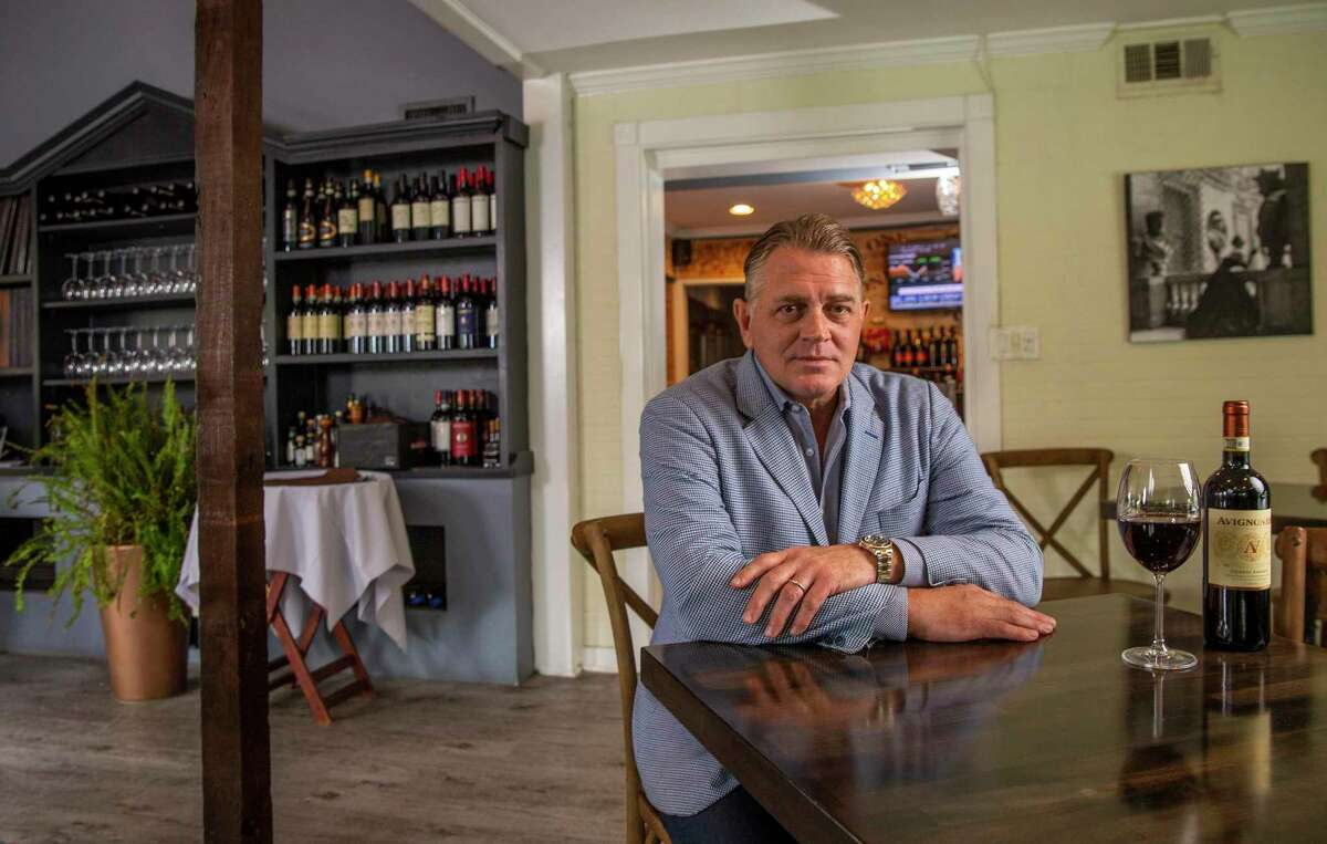 Shanon Scott , owner of Roma, an Italian restaurant in West University Place poses for a photo in the main dining room area on September 11, 2020 in his restaurant in Houston.
